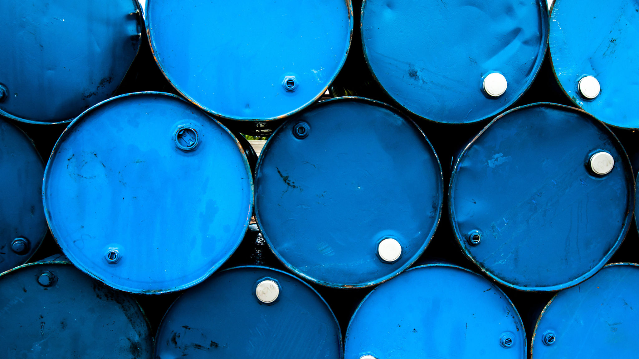 Oil slides as China hits US with new tariffs