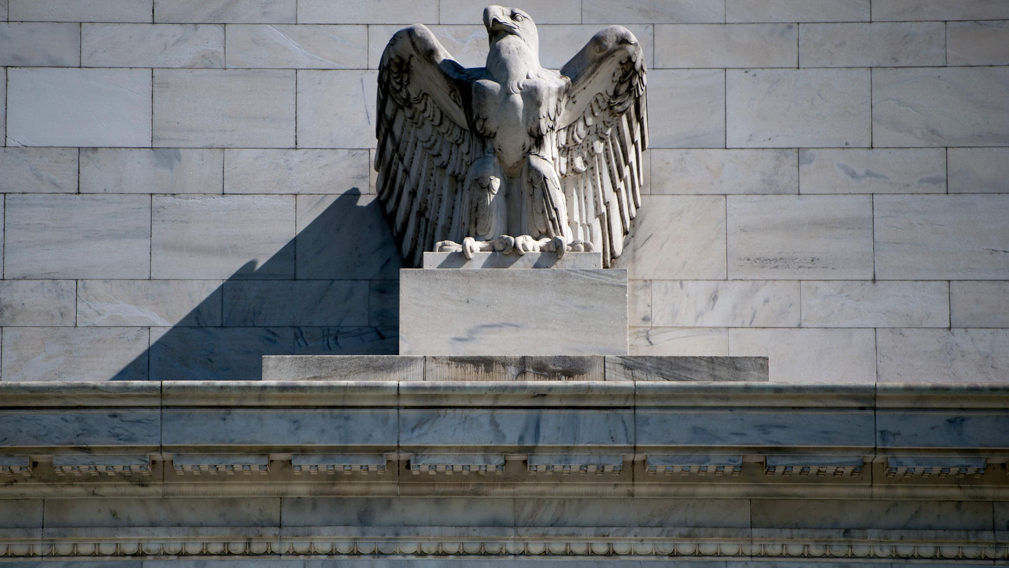 Fed says it will hold larger balance sheet in the long term