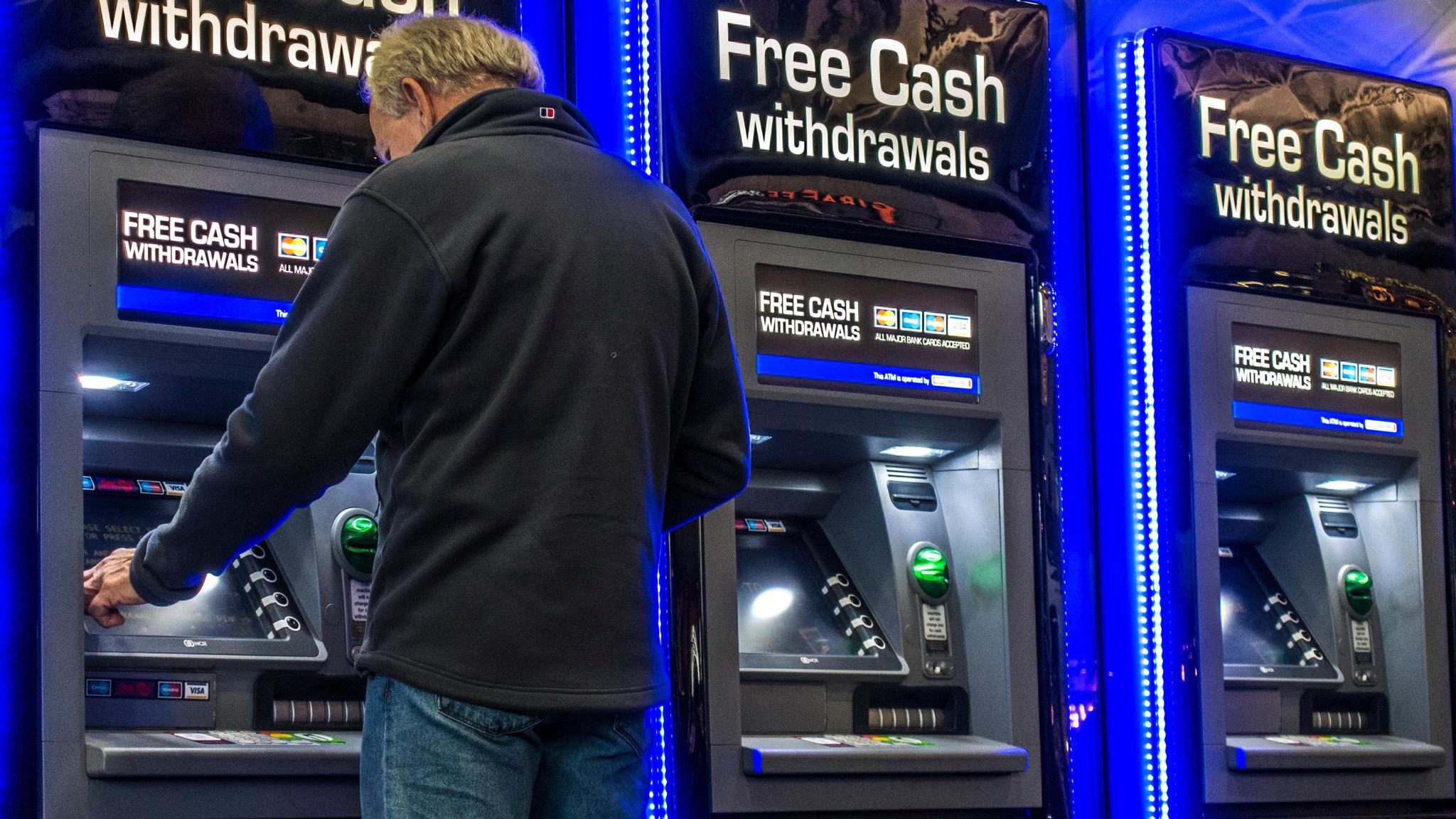 Cash machine operator threatens legal action against ATM