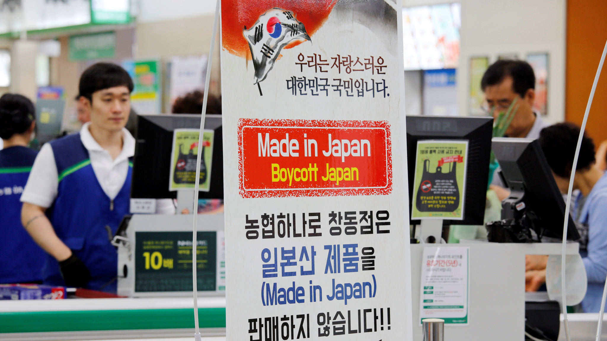 South Koreans vent anger with growing boycott of Japanese