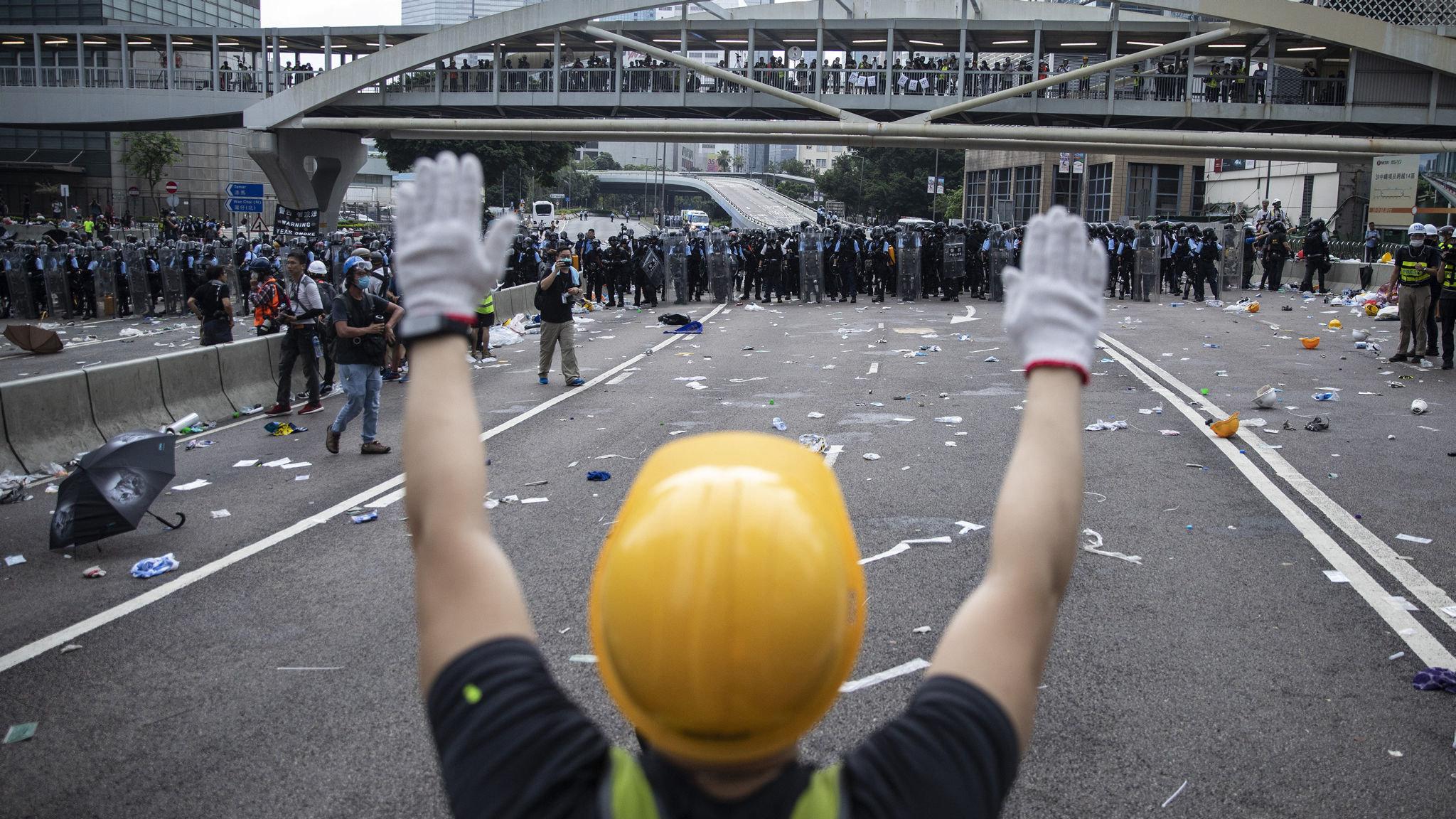 Hong Kong mood darkens as hard hats replace yellow umbrellas