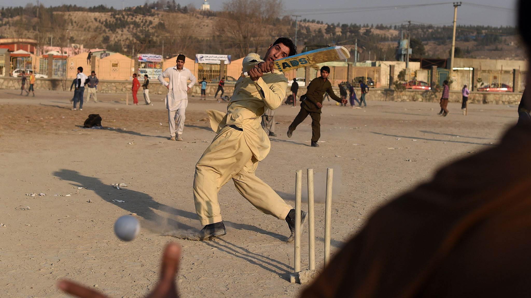 Image result for youth playing cricket in peshawar refugee camp