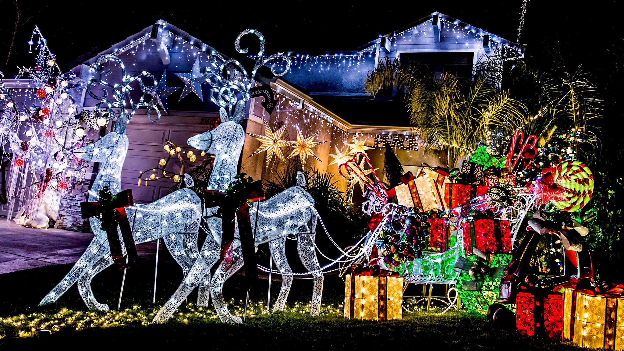 Christmas lights illuminate commercialism and community