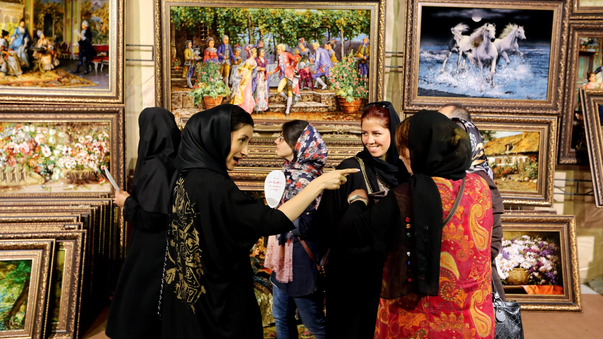 Iranian women lift headscarves in protest as discontent rises