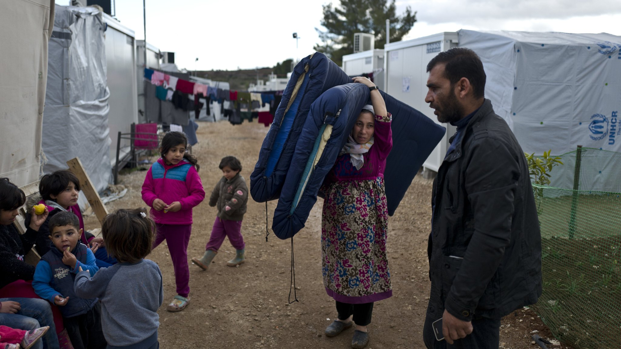 the struggles of syrian refugees in greece attempting to not return to turkey