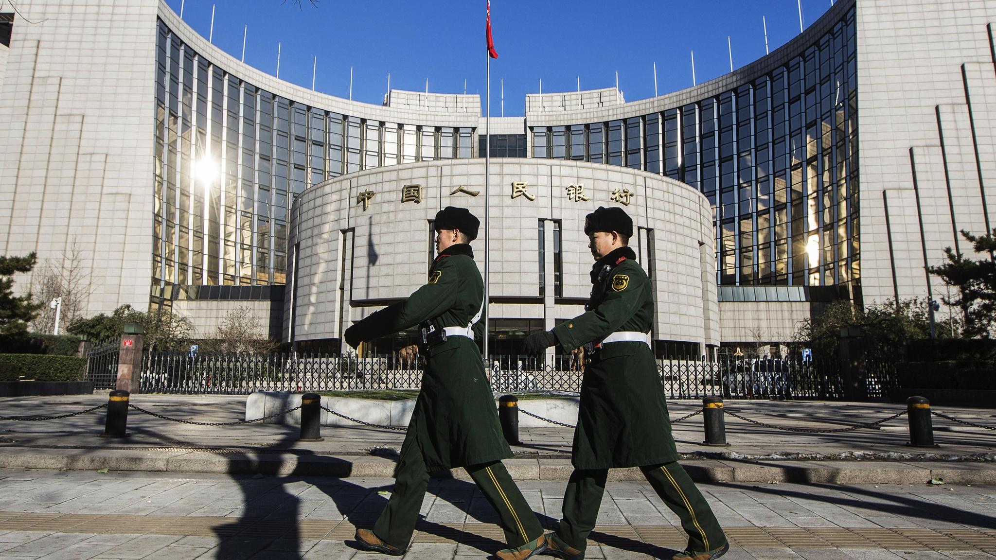 China trims benchmark lending rate, fails to buoy stocks