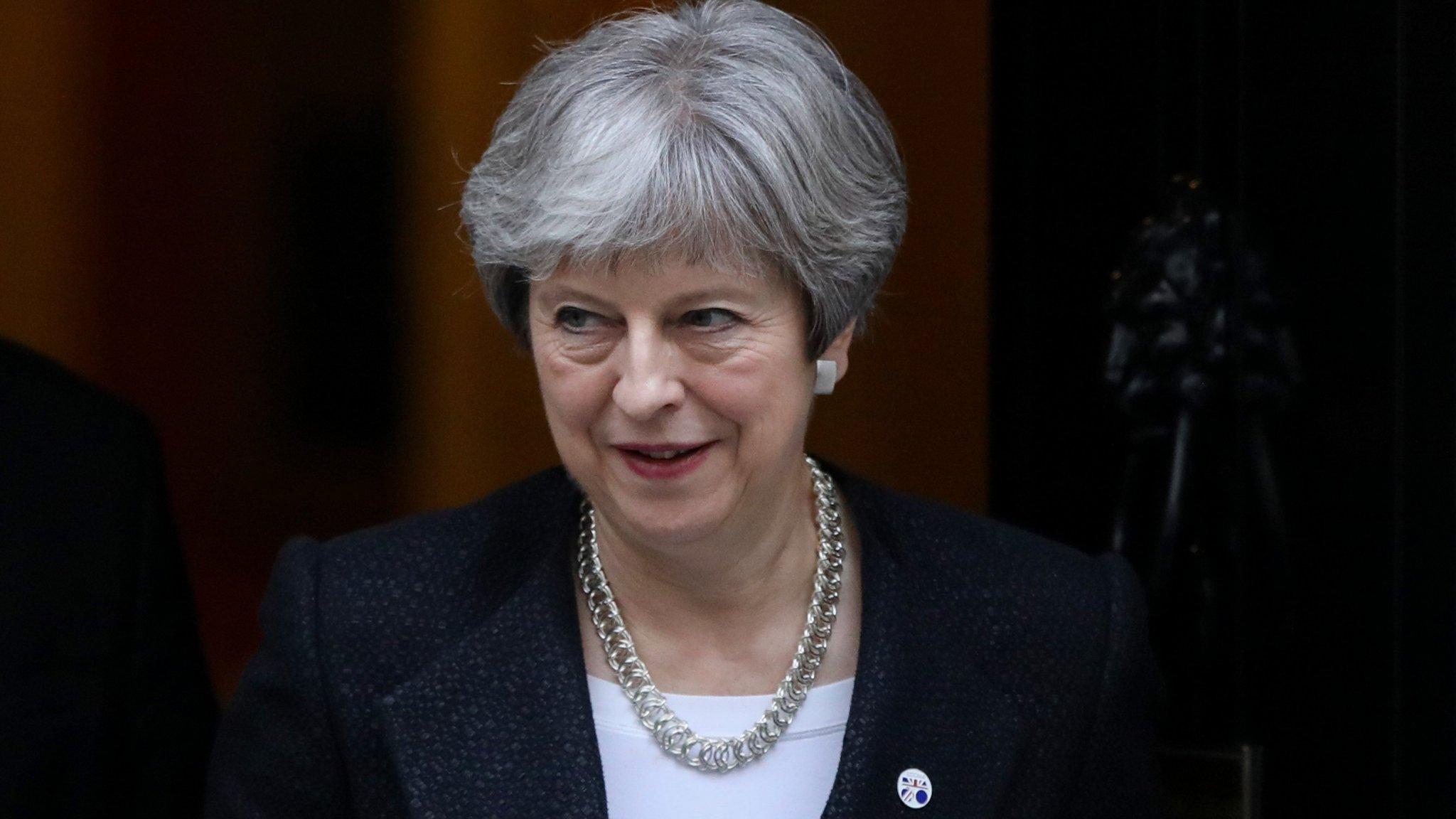 Theresa May warns China to play by global rules