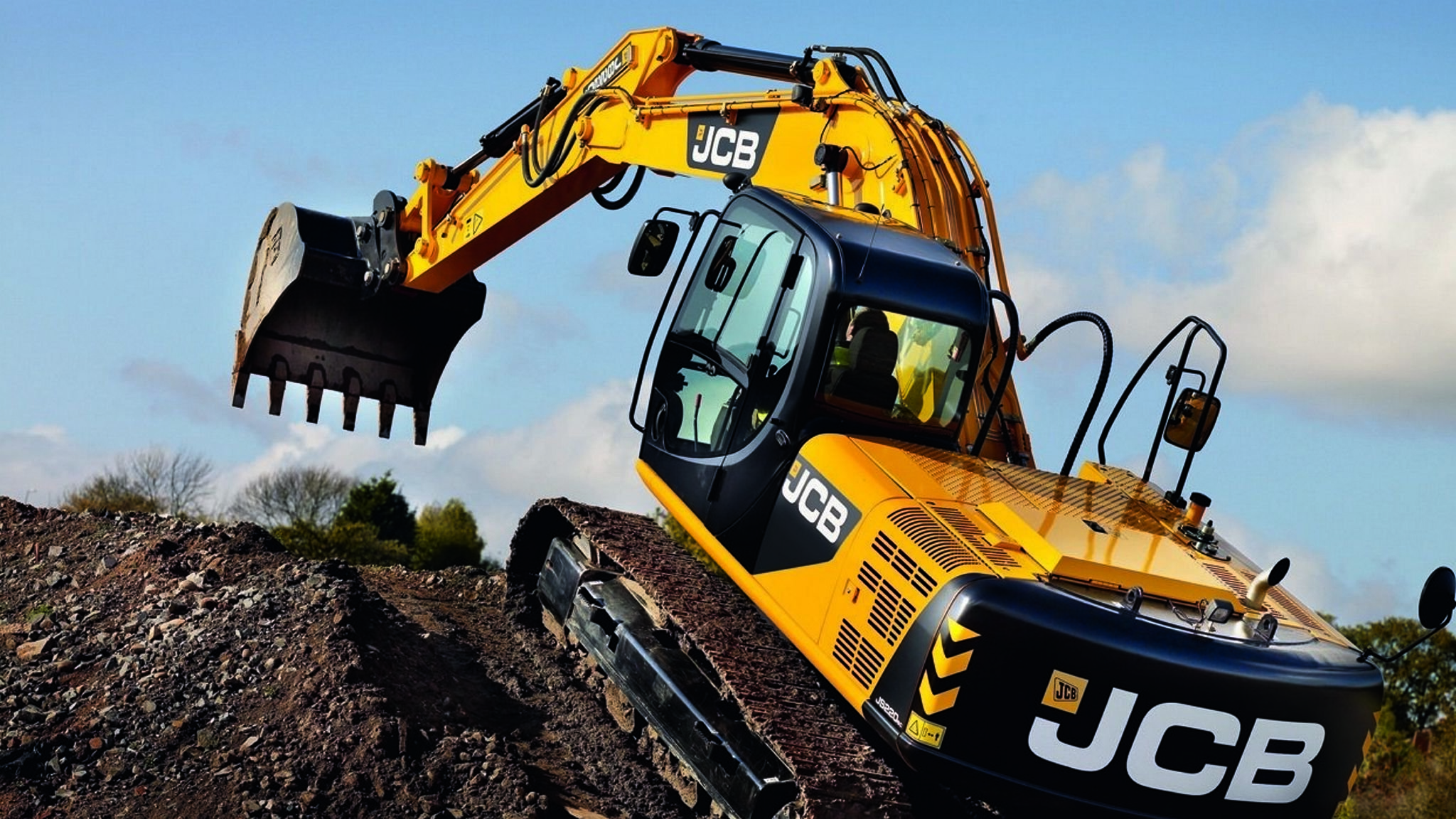 JCB warns that India's banking crisis is hurting demand