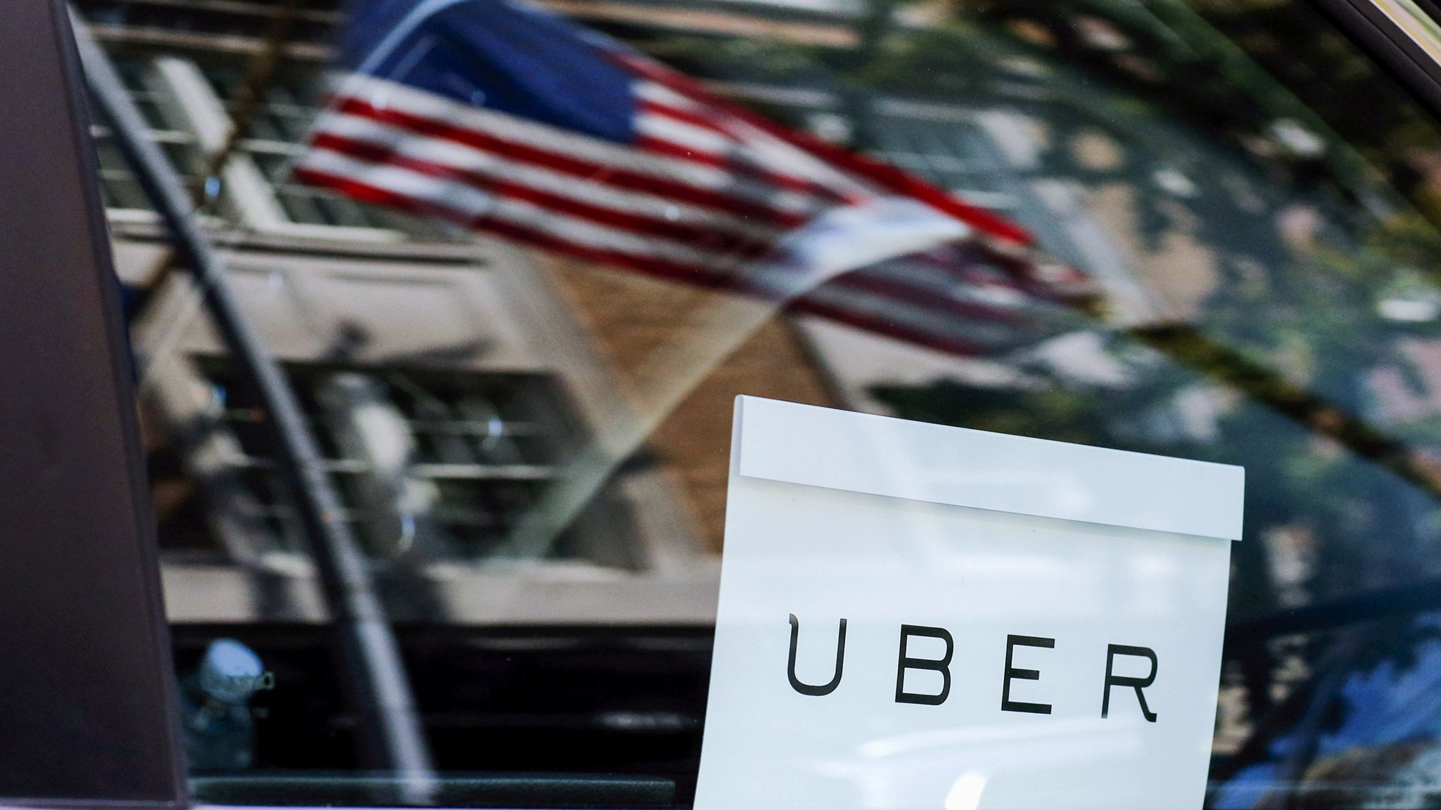 Uber losses widen as SoftBank investment looms