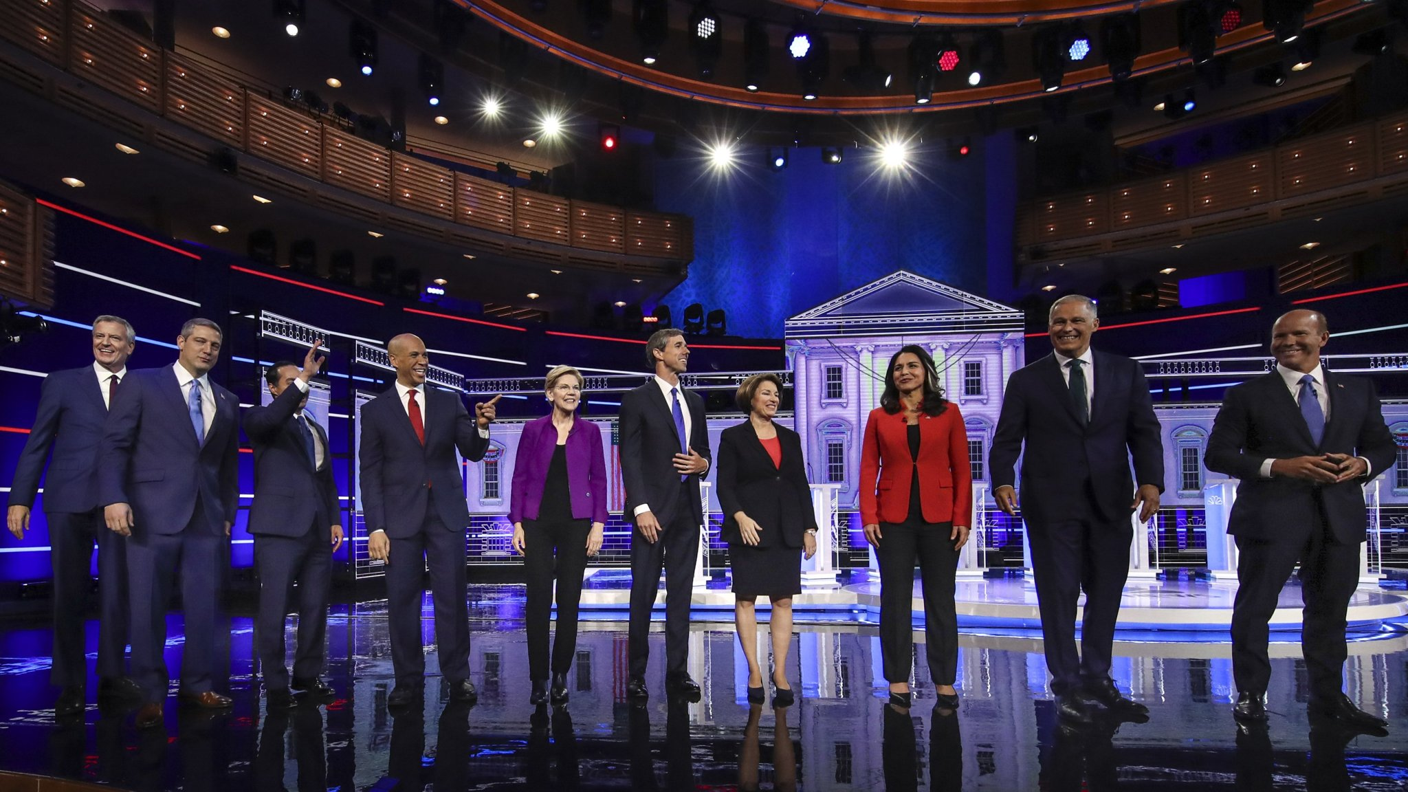 Democratic contenders spar over healthcare and migration