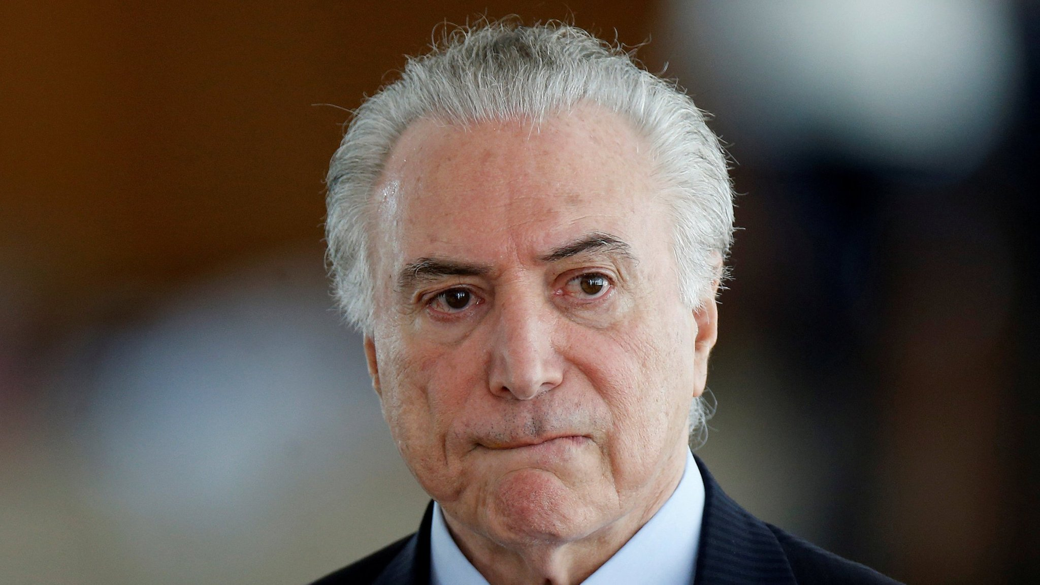 Blow for Michel Temer as S&P cuts Brazil credit rating