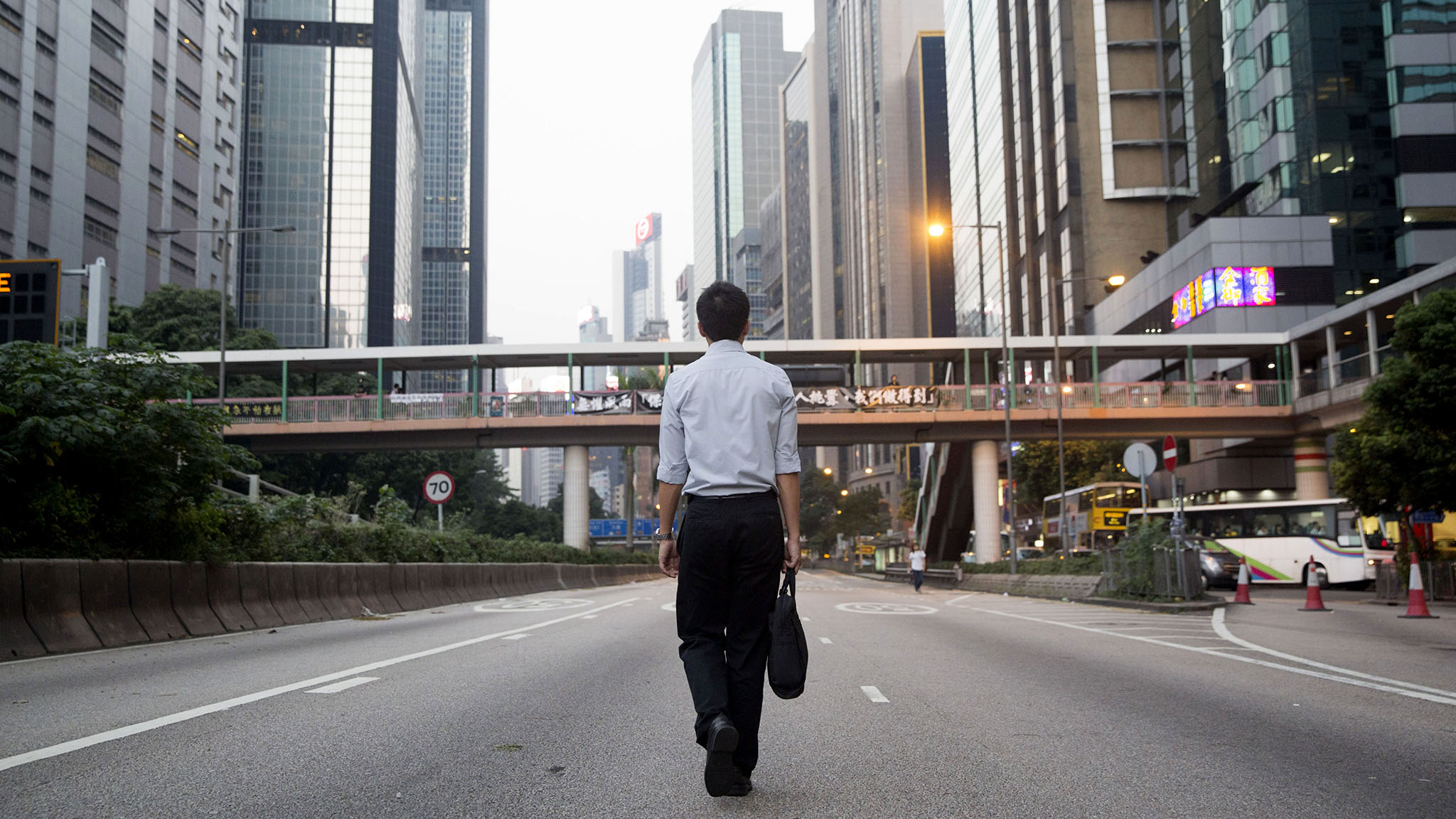 Political unrest adds to strains facing workers of Hong Kong
