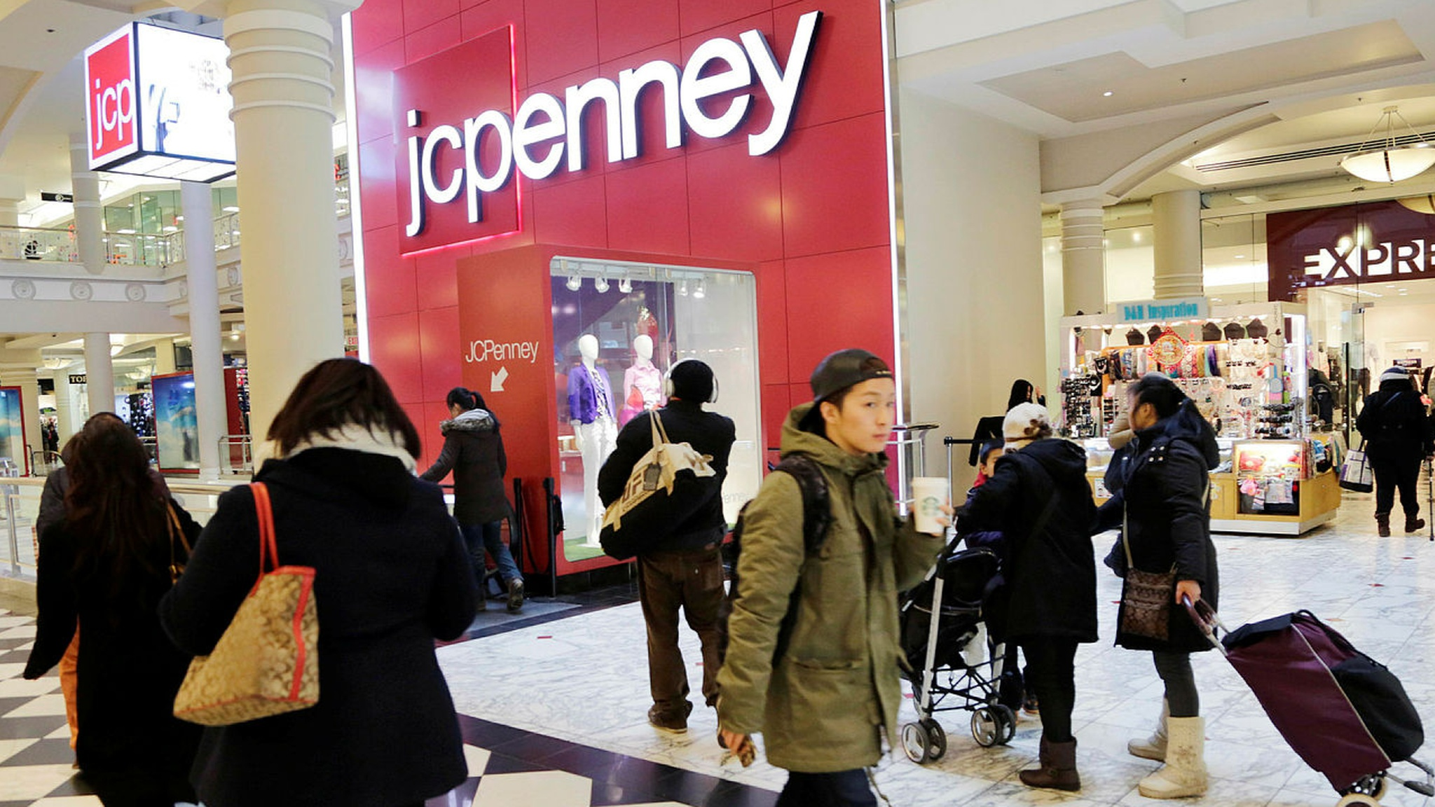 78e8d7ca8398 JCPenney shares plunge to record low as it cuts full-year outlook. US  department store chain reports disappointing sales ...