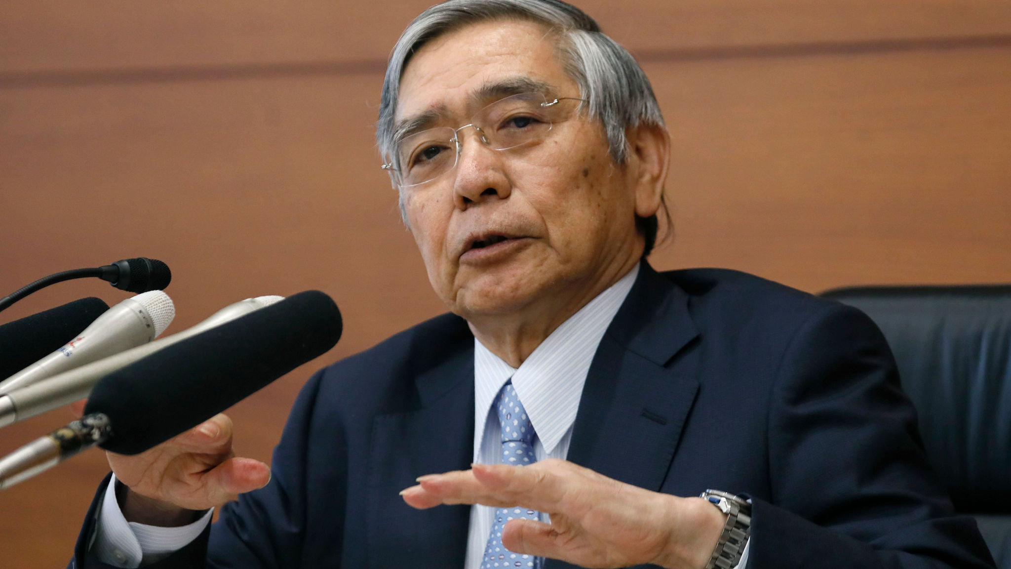 BoJ holds rates but vows easing if global events hit economy