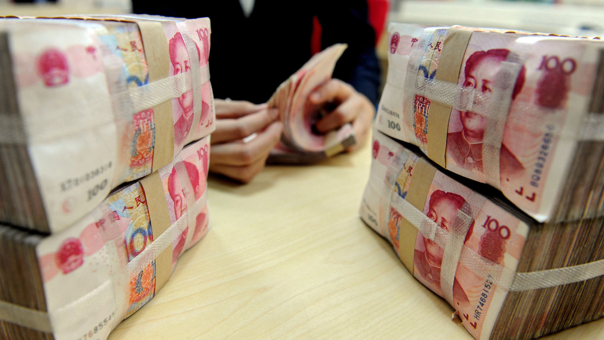 China's economy faces currency devaluation drag | Financial
