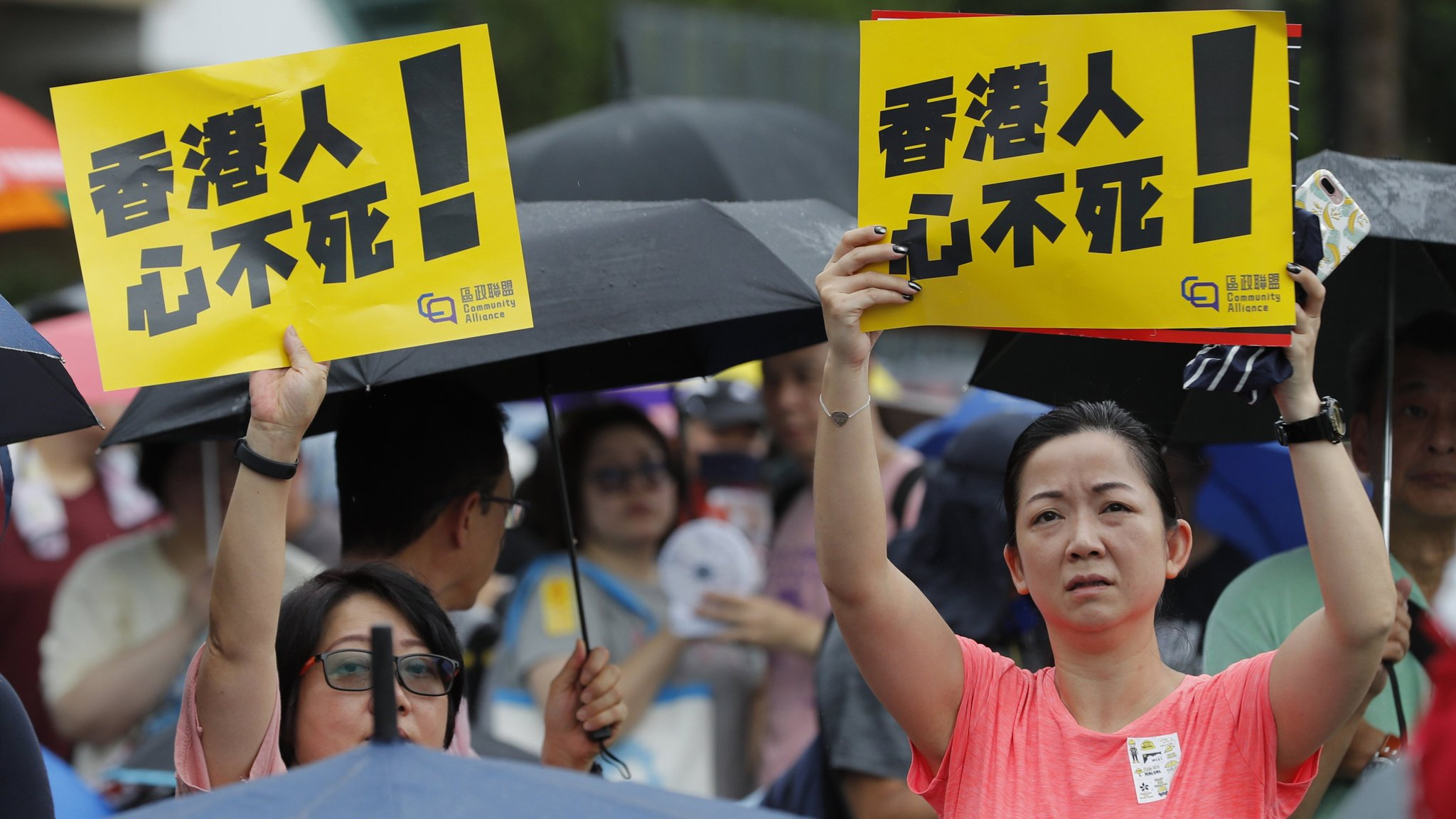 Hong Kong protesters defy Beijing's show of force