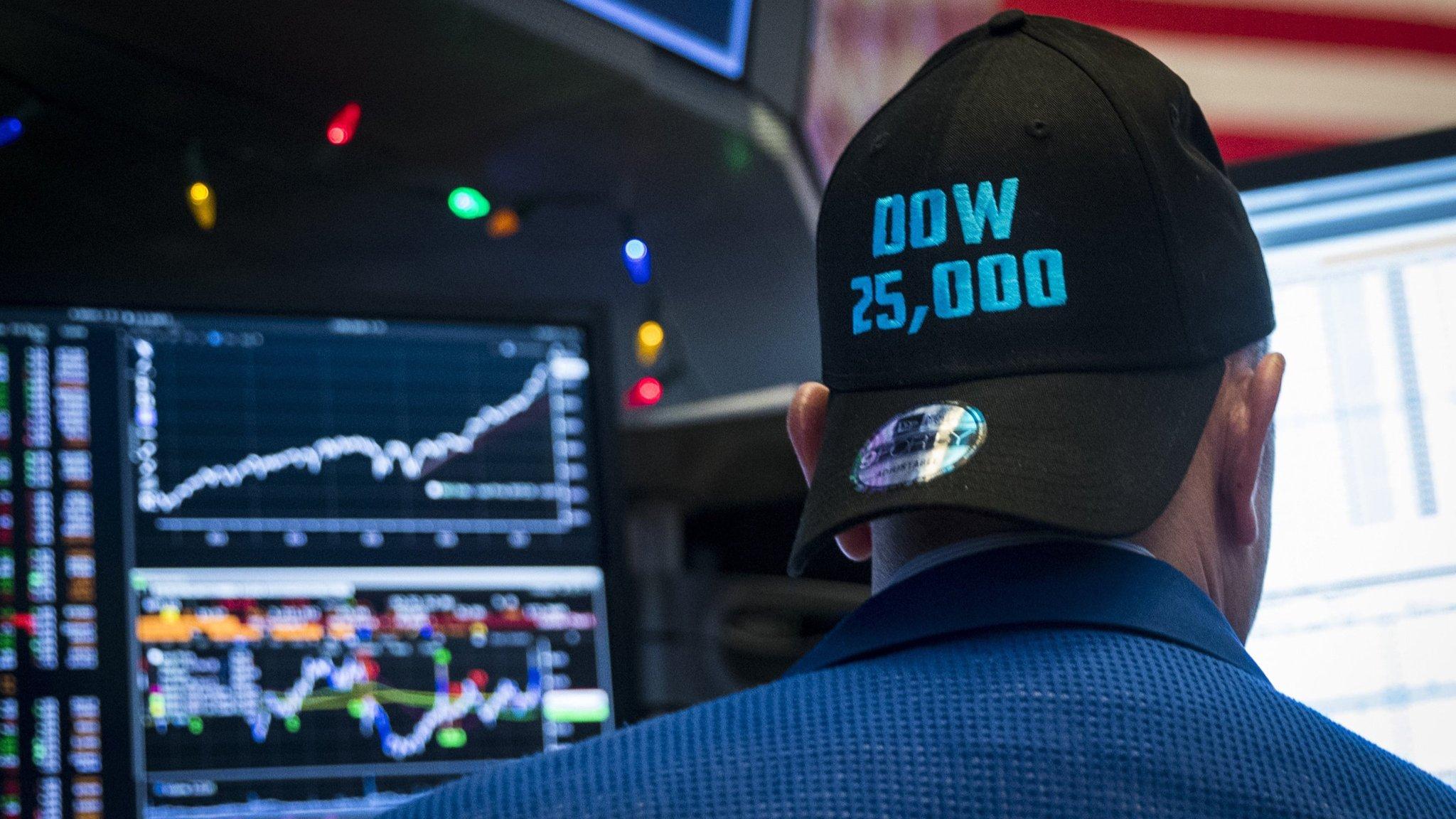 Dow surge past 25,000 lifts Asian markets